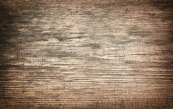 Brown grunge dirty scratched wooden cutting board Stock Photos