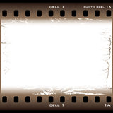 Brown grunge film cell. Single piece of film with brown grunge effect Stock Image
