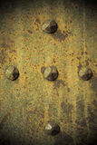 Brown grunge metal plate or armour texture with ri Stock Images