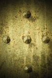 Brown grunge metal plate or armour texture with rivets Stock Image