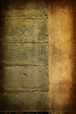 Brown grungy wall. Drama gold grunge wall in paris, ideal to create dramatic effects Stock Image