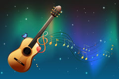A brown guitar with a butterfly and musical notes Royalty Free Stock Photo