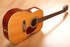Brown guitar on neutral background Royalty Free Stock Photo