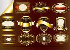 Brown guld-inramninde etiketter Royaltyfri Illustrationer