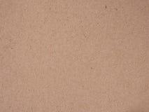 Brown ha riciclato la vecchia struttura di carta o il vecchio fondo leggero normale approssimativo del cartone del cartone marron Immagine Stock
