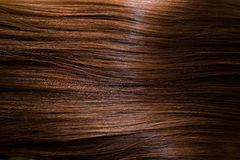 Brown hair. Close up on horizontal shiny brown hair Royalty Free Stock Photos
