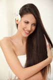 Brown Hair. Beautiful Brunette with Long Hair. Haircare. Royalty Free Stock Photo