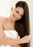 Brown Hair. Beautiful Brunette with Long Hair. Haircare. Royalty Free Stock Image