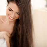 Brown Hair. Beautiful Brunette with long Hair. Smiling Girl Isol Royalty Free Stock Photo