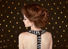 Brown hair. Beautiful elegant woman with hairstyle. Fashion girl Royalty Free Stock Photo