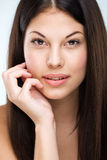 Brown hair, brown eyes, flawless face, bespectacled woman Stock Images