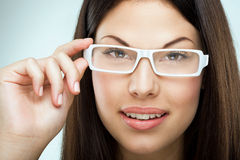 Brown hair, brown eyes, flawless face, bespectacled woman Royalty Free Stock Photos
