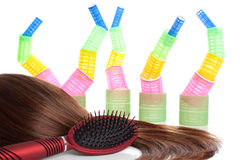 Brown hair, comb and hair curlers | Isolated Royalty Free Stock Image