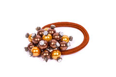 Brown hair elastic with a beautiful bouquet of beads Royalty Free Stock Photography