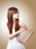 Fashion Woman with Brown Hair in wind Royalty Free Stock Image