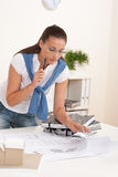 Brown hair female architect at the office Stock Image