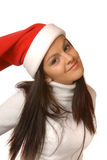 Brown hair girl with a christmas cap Stock Photography