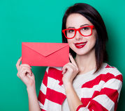 Brown hair girl with envelope. On green background Royalty Free Stock Photos