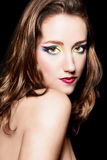 Brown hair girl with extravagant makeup. R Stock Image