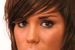 BROWN HAIR GIRL Eyes. Young Girl with brown hair and tanned Skin Stock Images