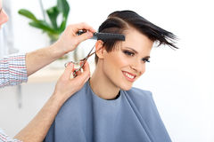 Brown Hair. Hairdresser Cutting Woman's Hair in Beauty Salon. Ha Stock Image