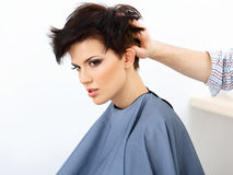 Brown Hair. The Hairdresser doing Hairstyle in Hair Salon. Royalty Free Stock Images
