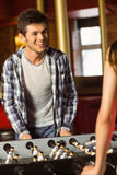 A brown hair playing table football Stock Images