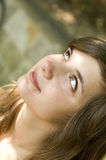 Brown hair smiling woman. Attractive young woman looking up Royalty Free Stock Images