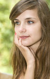 Brown hair smiling woman. Attractive young woman in park Stock Photography