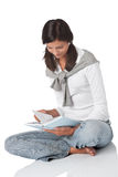 Brown hair teenager holding book Royalty Free Stock Photos