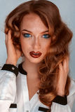 Brown hair woman with blue eyes and freckles on skin Royalty Free Stock Photos