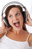 Brown hair woman enjoying music Stock Images