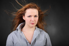 Brown hair woman with hair fluttering in wind Stock Photo