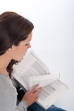 Brown hair woman reading book Stock Photo