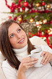 Brown hair woman relaxing with coffee on Christmas Stock Images