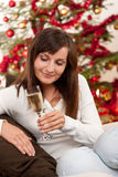 Brown hair woman sitting on Christmas Stock Image