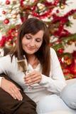 Brown hair woman sitting on Christmas Stock Image