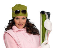 Brown hair woman in winter outfit with skis Royalty Free Stock Photos