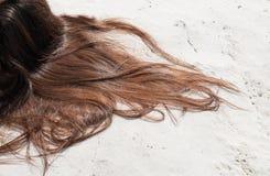 Brown hair of a woman Stock Photos