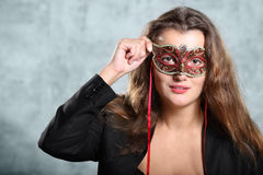 Brown hair young girl in mask. Portrait of beautiful long, brown hair young girl in mask in photo studio, half body stock illustration