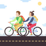 Brown-haired boy and red brunette girl on bikes. Vector illustration. Royalty Free Stock Photo