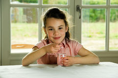 Brown haired child eating yogurt. Healthy lifstyle image Stock Photography