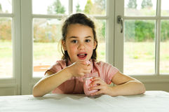 Brown haired child eating yogurt. Healthy lifstyle image Royalty Free Stock Photo