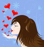 Brown-haired girl. On an abstract blue background brown-haired girl sends kisses Royalty Free Stock Images