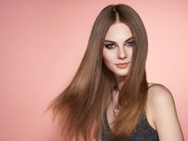 Brown-haired woman with long smooth hair royalty free stock image