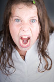 Brown Haired Girl Screaming at the Camera Stock Image
