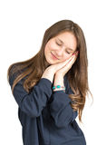 Brown-haired girl in shirt smiling in his sleep. On white background Stock Photos