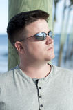 Brown Haired Man with Sunglasses Looking Away Stock Image
