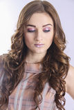 Brown-haired model with beautiful hair Stock Images
