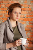 Brown-haired woman hold cup Stock Image